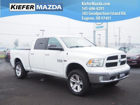Pre-Owned 2014 Ram 1500 4WD Crew Cab 149 Outdoorsman